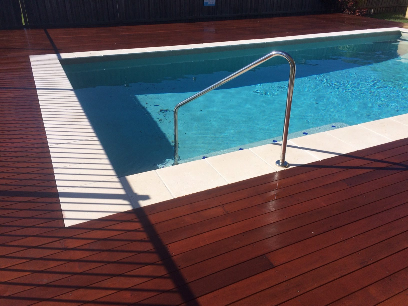 Pool deck homerite building services fraser coast for Timber decking around pools